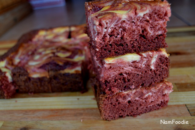 Red velvet cheesecake swirl brownies slices blur
